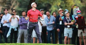 Rory McIlroy keeps a close eye on  a shot on the 18th hole during the second round of the WGC Mexico Championship at Club de Golf Chapultepec in Mexico City. Photograph: Hector Vivas/Getty Images