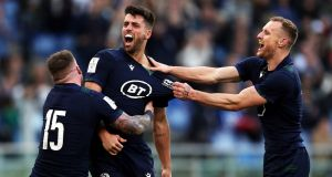 Scotland's Adam Hastings  celebrates scoring his side's final  try at the Stadio Olympico in  Rome.  Photo: Andrew Matthews/PA Wire.