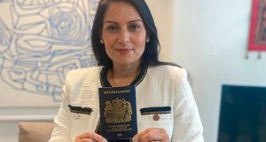 UK home secretary Priti Patel holding one of the new  blue passports, which will be issued for the first time in almost three decades from next month to mark the UK's departure from the European Union. Photograph: Home Office/PA Wire