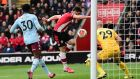 Shane Long scores for Southampton against Aston Villa at St Mary's Stadium. Photograph: Getty Images