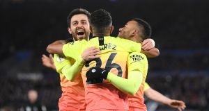Gabriel Jesus of Manchester City celebrates with Bernardo Silva and Riyad Mahrez after scoring his team's winner at The King Power Stadium. Photograph: Laurence Griffiths/Getty Images