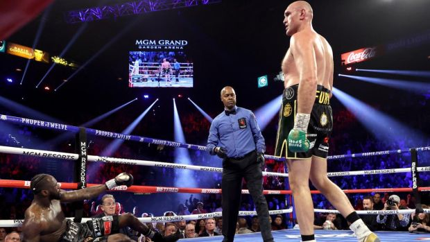 Tyson Fury knocks Deontay Wilder down in the third in Las Vegas. Photograph: Al Bello/Getty