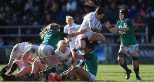 England's Leanne Riley is tackled by Ireland's Sene Naoupu during the   match at Castle Park. Photo: Adam Davy/PA Wire.