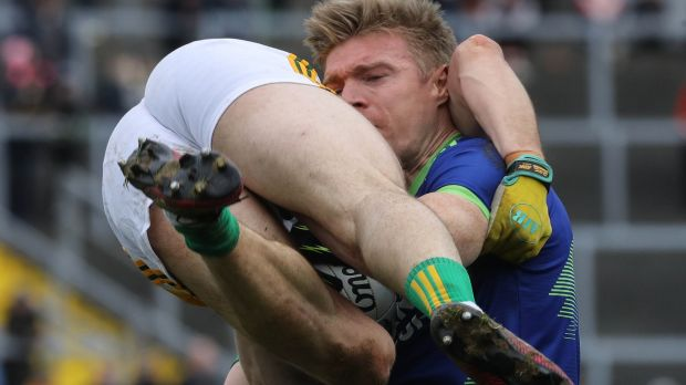 Kerry's Tommy Walsh tangles with Conor McGill of Meath. Photograph: Lorraine O'Sullivan/Inpho