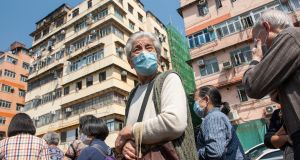 Residents queue for free masks in Hong Kong, China.  Photograph: EPA/Miguel Candela