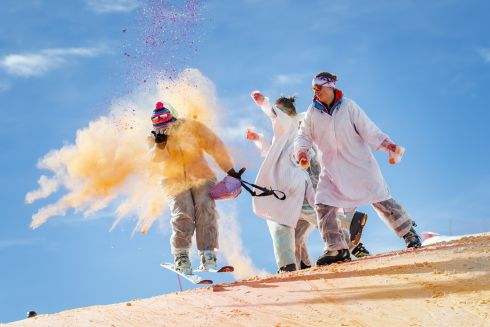 Skiers take part in the Skicolor event where they are sprayed with biodegradable color powders as part of carnival celebrations in the alpine resort of La Tzoumaz, Switzerland. Photograph: Valentin Flauraud/EPA