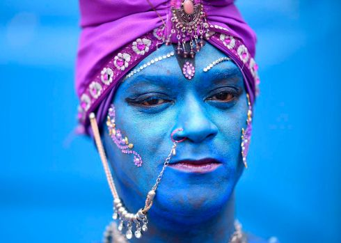 A member of the Pena de Pavao de Krishna traditional carnival group, which celebrates Indian deities, in Belo Horizonte, Brazil. Photograph: Douglas Magno/AFP