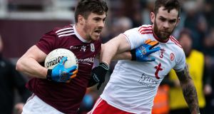 Galway's Shane Walsh sees off Tyrone's Ronan McNamee at Tuam Stadium. Photograph: Evan Logan/Inpho
