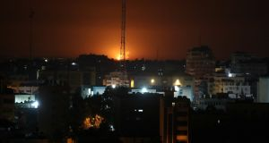 Flame and smoke are seen during an Israeli air strike in Gaza  on Sunday. Photograph: Mohammed Salem/Reuters