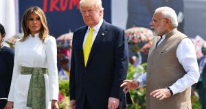 India's prime minister Narendra Modi speaks with US president Donald Trump  and first lady Melania Trump  upon their arrival at Sardar Vallabhbhai Patel International Airport in Ahmedabad on Monday. Photograph:  Mandel Ngan/AFP