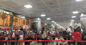 Passengers queuing at Tenerife South airport on Sunday. Photograph: PA