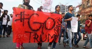 Leftist students activists shout slogans as they protest against the visit of US President Donald Trump to India, in Kolkata on Monday. Photograph: Dibyangshu Sarkar/AFP/Getty Images)