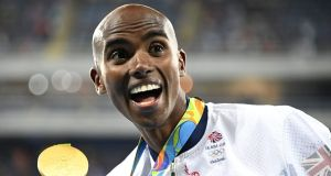 Mo Farah with his gold medal at the Rio 2016 Olympic Games. Photograph: Getty Images