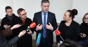 Sinn Féin TD Pearse Doherty speaks to the media alongside  party colleagues  Eoin Ó Broin TD and Louise O'Reilly TD. Photograph: Dara Mac Dónaill/The Irish Times.
