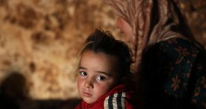 A displaced child looks on at an underground shelter in the Taltouna village, 17 km northwest of the city of Idlib on Saturday. Photograph: Yahya Nemah/ EPA