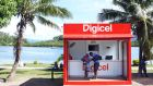 Customers shop at a Digicel store  in Fiji. The group's net debt currently stands at about $6.8 billion. Photograph: iStock