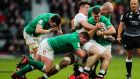 Johnny Sexton is tackled by England's Tom Curry during Ireland's defeat at Twickenham.  Photograph: Billy Stickand/Inpho