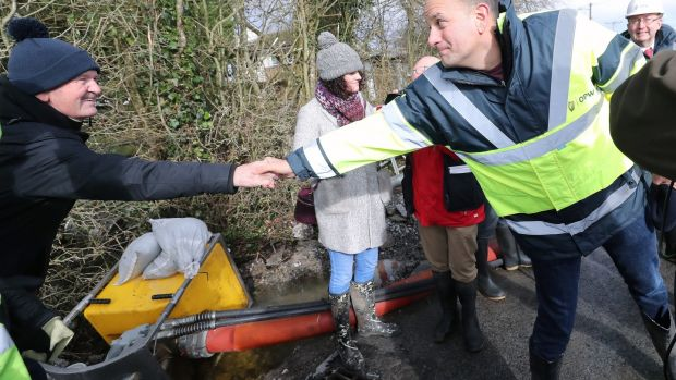 Taoiseach Leo Varadkar shakes hands with members of the public as he visits flood prevention measures in Athlone, Co Westmeath. Photograph: Niall Carson/PA Wire