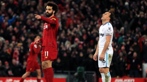 Mohamed Salah celebrates after scoring Liverpool's equaliser while Mark Noble looks dejected. Photograph: Peter Byrne/PA
