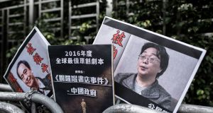 A file photograph from January 2016 shows placards showing missing bookseller Lee Bo (L) and his associate Gui Minhai outside the China liaison office in Hong Kong. Photograph: Getty Images