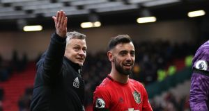 Ole Gunnar Solskjaer with new signing Bruno Fernandes after Manchester United's win over Watford. Photograph: Clive Brunskill/Getty