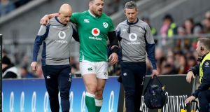 Ireland's Cian Healy leaves the field injured during Saturday's Six Nations loss to England. Photo: Billy Stickand/Inpho