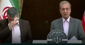 Iran's deputy health minister Iraj Harichi (left) at a press conference on Monday in which he downplayed the coronavirus's spread in the  city of Qom and said mass quarantines were unnecessary. Photograph: Screengrab