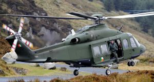 An Air Corps helicopter in Co Wicklow. The State would need about 16 jet fighters  to implement a full air defence capability, an expert has said. File photograph: Aidan Crawley