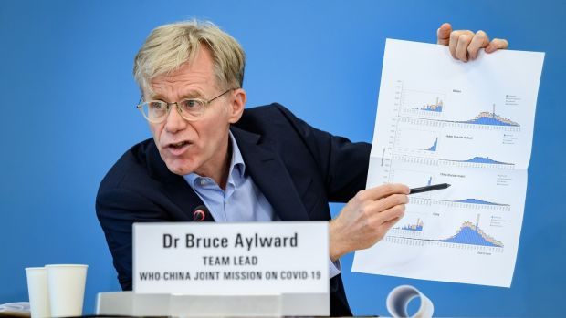 Team leader of the joint mission between the World Health Organisation (WHO) and China on covid-19, Bruce Aylward shows graphics during a press conference in Geneva on February 25th, 2020. Photograph: Fabrice Coffrini/AFP/Getty Images.
