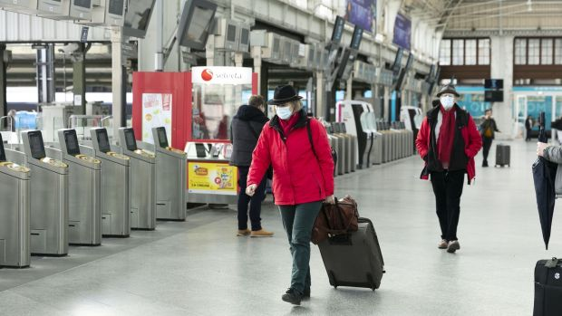 Travelers wear face masks after in Paris at Gare de Lyon railway station. Photograph: Laura Stevens/Bloomberg.