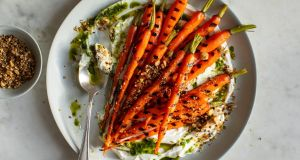 Grilled carrots with yogurt, carrot-top oil and dukkah: Photographs: Andrew Scrivani/The New York Times