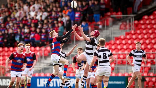 St. Munchin's Alex Wood goes up for the ball with Darragh McSweeney of PBC during the Clayton Hotels Munster Schools Senior Cup semi-final at Musgrave Park. Photograph: Tommy Dickson/Inpho
