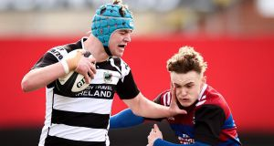 David O'Halloran of PBC tries to hand off St Munchin's James O'Brien during the Clayton Hotels Munster Schools Senior Cup semi-final at Musgrave Park. Photograph: Tommy Dickson/Inpho