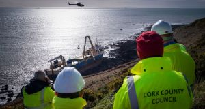 'GHOST' SHIP: Cork County Council engineers during efforts to remove oil and other possible contaminants from the grounded cargo ship MV Alta off the coast of Ballycotton, Co Cork. Photograph: Daragh Mc Sweeney/Provision