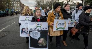 The group Wives and Partners of the Defence Forces marching  to the Dáil last year in protest at  low pay levels for military personnel. Photograph: Brenda Fitzsimons