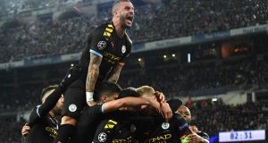 Kyle Walker joins in as Kevin De Bruyne of  celebrates with team-mates after scoring his team's second goal during the  Champions League round of 16 first leg match against  Real Madrid  at the  Bernabeu. Photograph: David Ramos/Getty Images