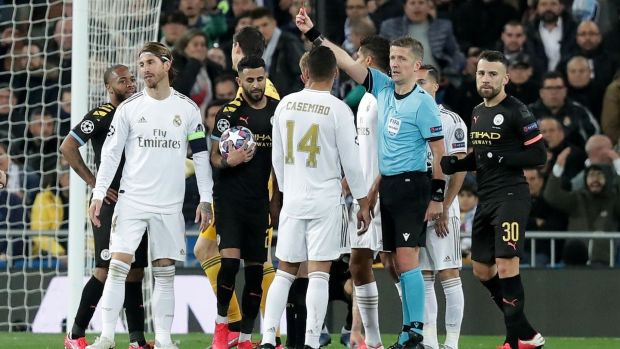Referee Daniele Orsato sends off Real Madrid's Sergio Ramos during the Champions League round of 16 first leg match at the Bernabeu. Photograph: Gonzalo Arroyo Moreno/Getty Images
