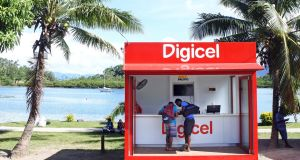 Customers shop at a Digicel store for mobile phones in Savusavu, Fiji