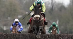 Sam Twiston-Davies riding Clan Des Obeaux clears the last hurdle to win The Ladbrokes King George VI Chase at Kempton Park Racecourse on December 26th, 2019 in Sunbury, England. Photograph:  Alan Crowhurst/Getty