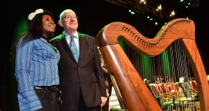 Mabel Chah from Cameroon with Minister for Justice Charlie Flanagan  at a citizenship ceremony in the INEC, Killarney on December 9th. Photograph: Don MacMonagle