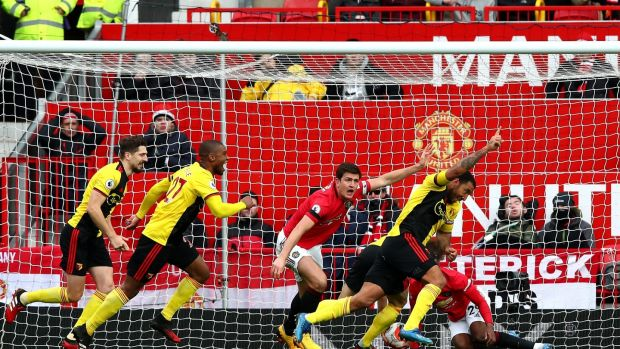 Troy Deeney scores for Watford at Old Trafford before it was disallowed by VAR. Photo: Clive Brunskill/Getty Images