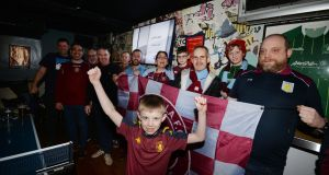 Aston Villa fan club members, including chairman Philip Drew (right), watch a Premier League match in Temple Bar. Photograph: Alan Betson