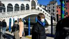 A man wearing a protective mask in Venice. Photograph: Claudio Furlan/Lapresse via AP