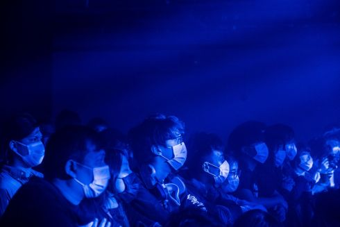 MASK MUSIC: People wearing face masks watch a performance at a concert venue in Hong Kong. Photograph: Lam Yik Fei/New York Times