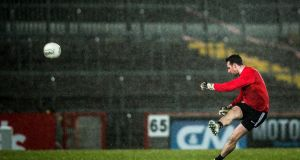 Tyrone's Niall Morgan kicks a free in his team's win over Dublin. Photograph: Tommy Dickson/Inpho