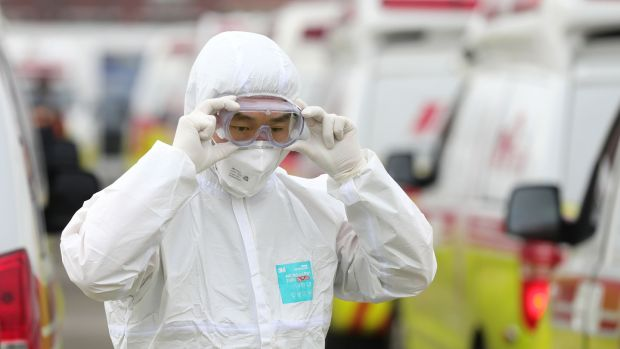 A South Korean paramedic wearing protective in Daegu on Sunday. Photograph: /Yonhap/AFP/Getty