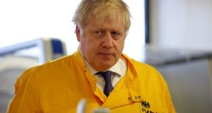 Britain's prime minister Boris Johnson visits a laboratory at the Public Health England National Infection Service in  north London. Photograph: Henry Nicholls/ AFP