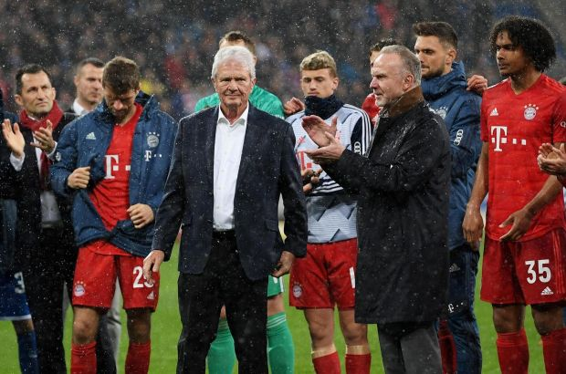 Karl-Heinz Rummenigge and Dietmar Hopp (centre) come together with players to applaud the home fans after demonstrations at the Bundesliga match between Hoffenheim and FC Bayern Muenchen on Saturday in Sinsheim, Germany. Photograph: Matthias Hangst/Bongarts/Getty