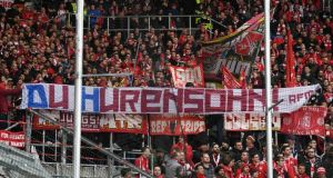 Fans of FC Bayern Muenchen  show a banner against billionaire Hoffenheim owner Dietmar Hopp during the Bundesliga match the sides at PreZero-Arena on February 29th in Sinsheim, Germany. Photograph: Matthias Hangst/Bongarts/Getty