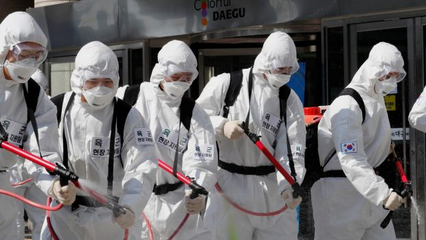 Irish backstop - South Korean soldiers wearing protective gear sanitise a street in front of the city hall after the rapid rise in confirmed cases of the novel coronavirus disease of (COVID-19) in Daegu, southeast of the capital Seoul, South Korea, on Monday. Photograph: Reuters